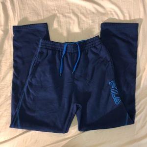 blue fila track pants/ sweatpants